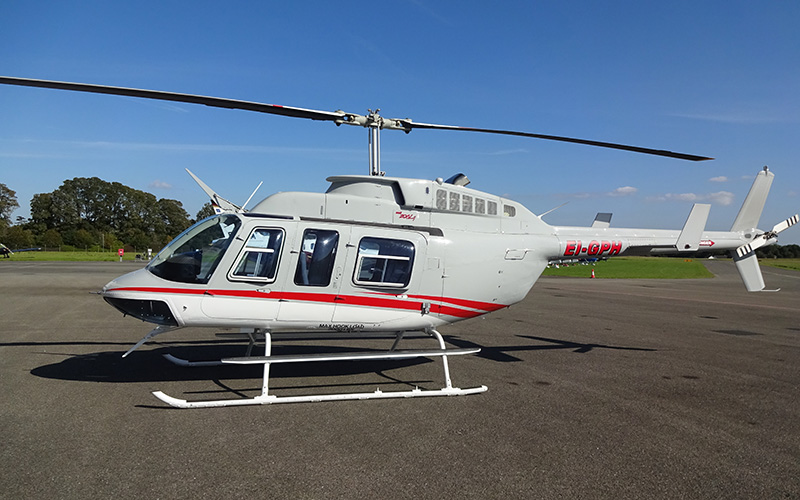 Bell206L4 helicopter on the main apron in Weston Airport, Dublin