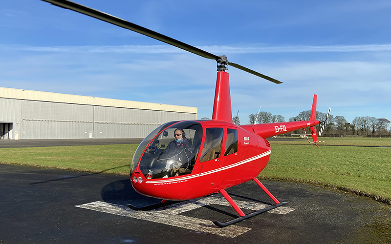 R44 Helicopter on helipad in Weston airport, Dublin